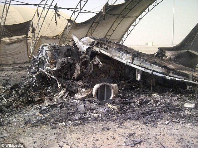 Devastation: The following picture shows what remains of one of the six Harrier jets in the aftermath of the Taliban attack on Camp Bastion on Sept. 14, 2012