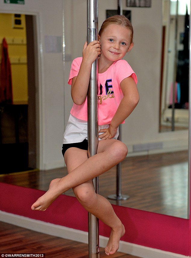 Work out: Seven-year-old Alexis Biggs practises her moves on the pole