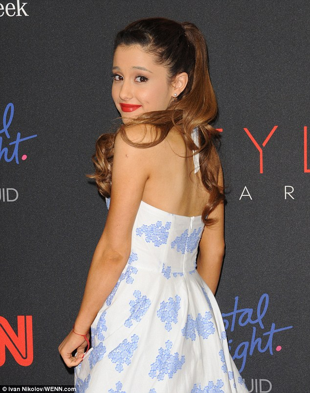 Dimpled beauty: Ariana finished off her pin-up style ensemble with red lips, nude pumps, and a freshly curled ponytail extension
