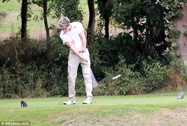 Irish heartthrob Niall practices his swing on Thursday