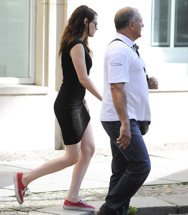 Personal touch: She stayed true to her casual roots, however, pairing the dress with red trainers