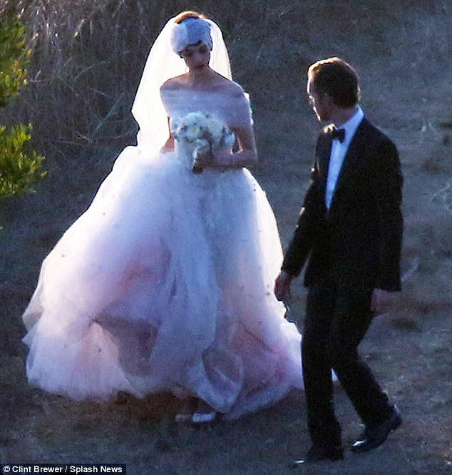 Stunning: Anne wore a white and gauzy pink custom creation by Valentino for her September 29, 2012 wedding to Adam in Big Sur, California