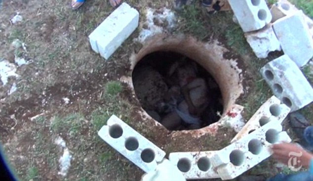 Brutal: The bodies of the soldiers are dumped in a well after they are shot dead by the rebels