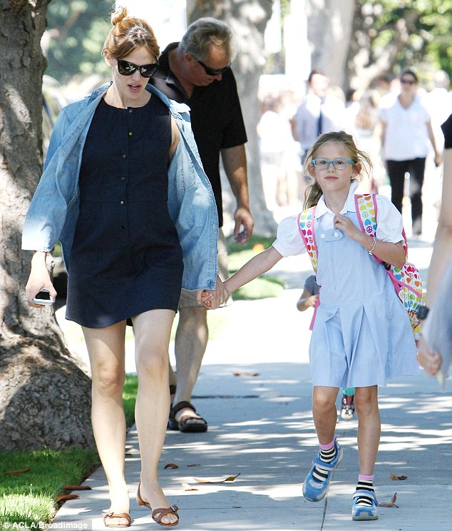Colour-coordinated: Jennifer Garner picked up her daughter Violet from school in Santa Monica, California on Wednesday wearing a blue denim shirt that matched Violet's pinafore