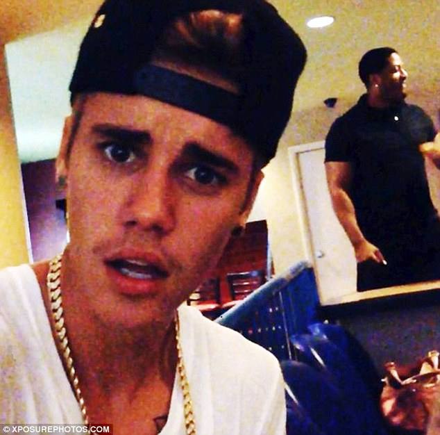 Studio time: The same day Justin posted a photo on Twitter along with the words: 'Me and Terrell Owens'