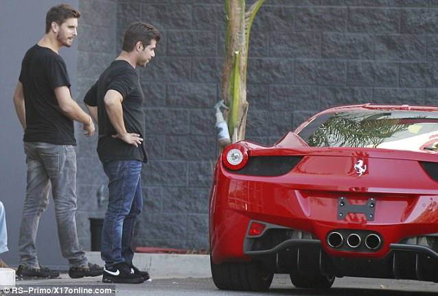 Partner in crime: Rob Kardashian, right, joined the father-of-two during the dealership deal