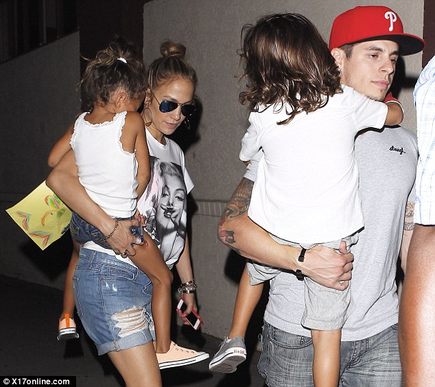 Cuddling up: Jennifer toted little Emme while Casper carried Max
