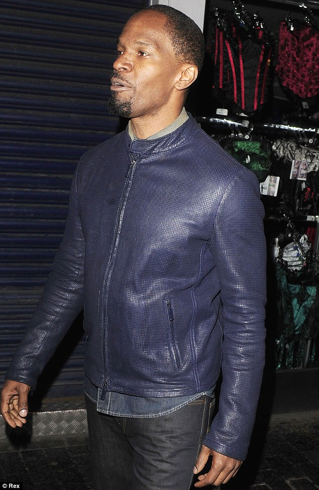 Cool dude: Jamie Foxx looked cool in a blue leather zipped jacket for the night out