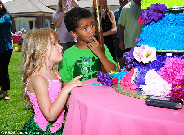Tucking in: Birthday girl Stella and her friend look in awe at the intricately designed multi-coloured cake
