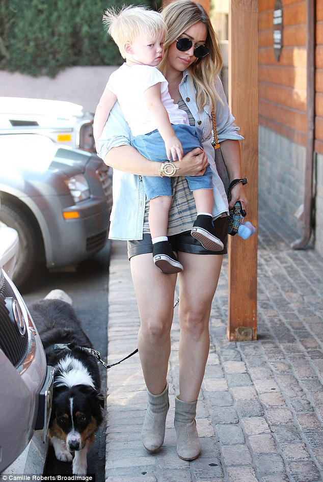 Happy mom: Hilary Duff smiled after she and son Luca on Thursday took the family dog to visit a veterinarian in Los Angeles
