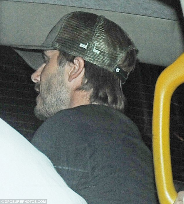 Bleary eyed: The former footballer looked tired after his night out in the capital