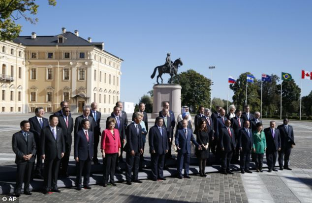 Group photo: Russia's President Vladimir Putin, center front, stands with G-20 leaders during a group photo outside of the Konstantin Palac