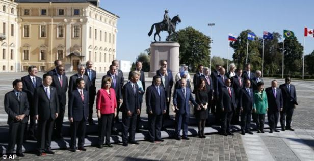 Say 'cheese': Russia's President Vladimir Putin, center front, stands with G-20 leaders during a group photo outside of the Konstantin Palace in St. Petersburg, Russia on Friday, where Syria's civil war became the hot topic of conversation