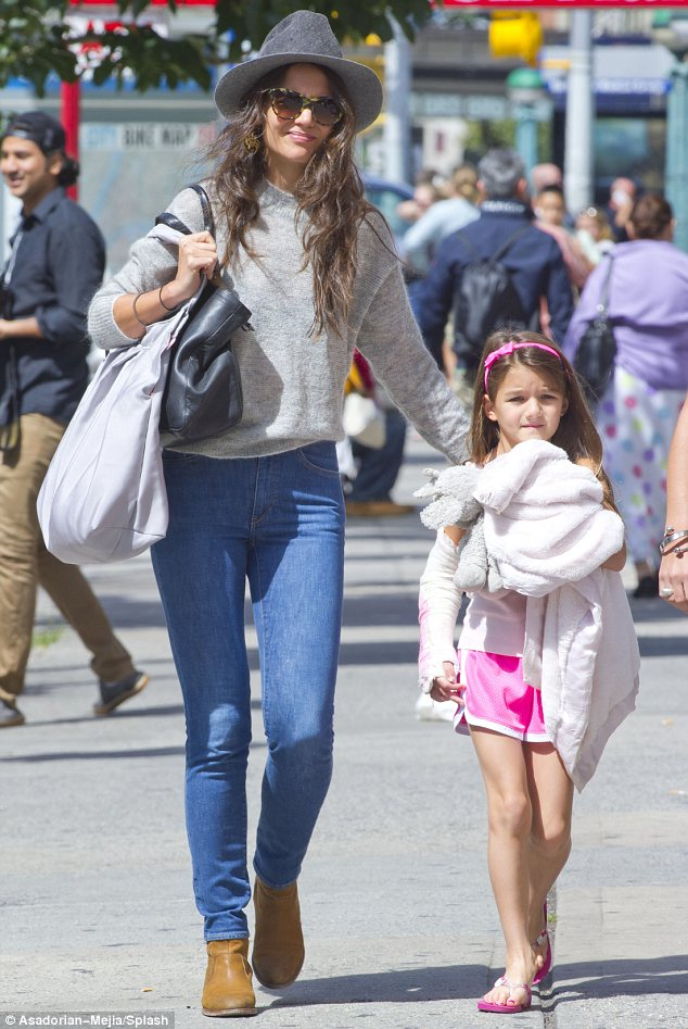 Recovering: Suri Cruise was in good spirits during a stroll in New York with her mother Katie Holmes, just one week after breaking her arm