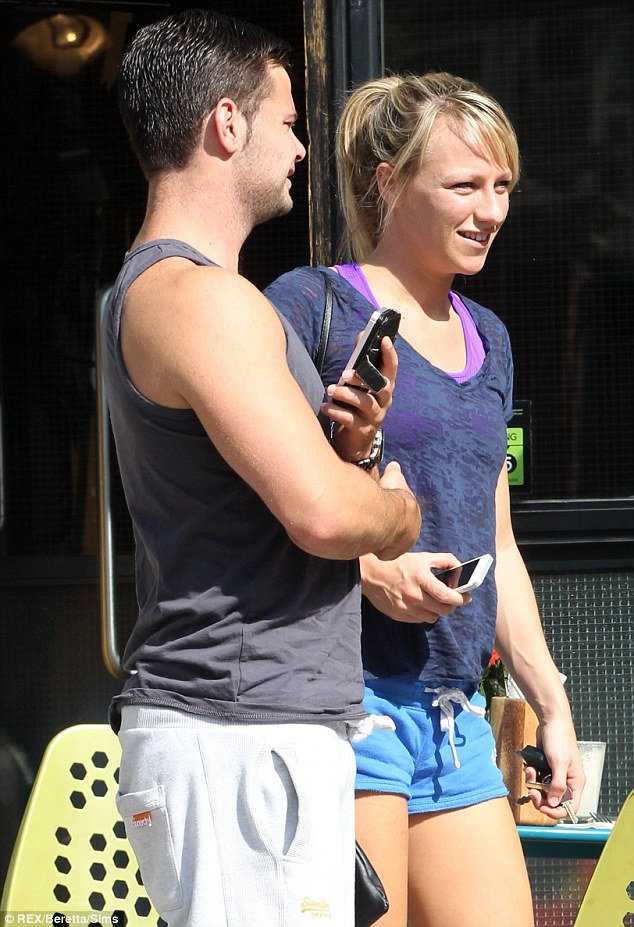 Daytime date: The couple appeared to have hit the gym, before unwinding in a cafe for the afternoon