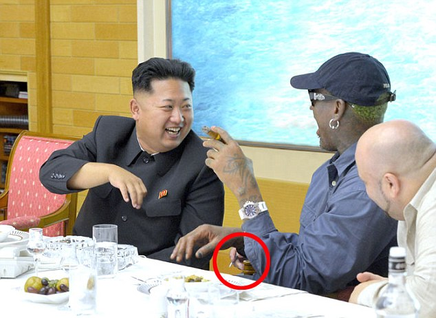 Whose hand is that? Rodman and Kim Jong Un - and a mysterious (possibly photoshopped?) third hand - in North Korea