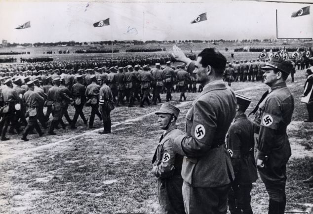 Rudolf Hess gives the Nazi salute at the inauguration ceremony of the Adolf Hitler Canal, in Germany, in 1939