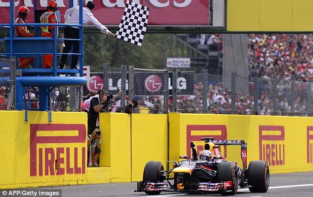 Finish: Sebastien Vettel celebrates uet another win this season in Italy
