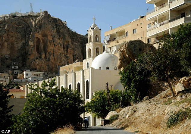State-run TV reported that all churches in Maaloula were now safe and the army was chasing gunmen in the western hills