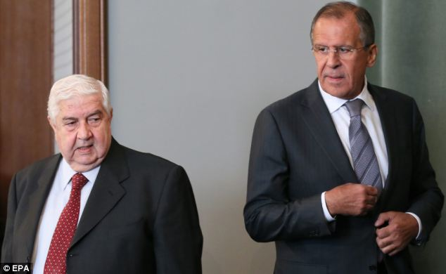 Russian Foreign Minister Sergei Lavrov (R) and Syrian Foreign Minister Walid al-Moualem (L) met Monday in Moscow. Russia's government remains one of Syria's only allies
