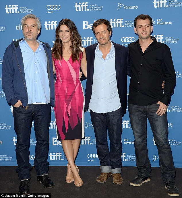 Clooney free: And while director Alfonso Cuaron, producer David Heyman, and screenwriter Jonas Cuaron were all present, George Clooney was busy shooting Tomorrowland in Vancouver