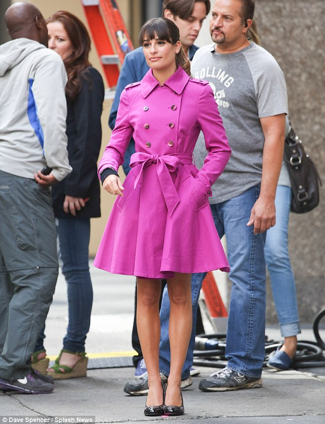 Very berry: Lea Michele brightened up New York on Monday in a fuchsia trench coat to film scenes for Glee's fifth season