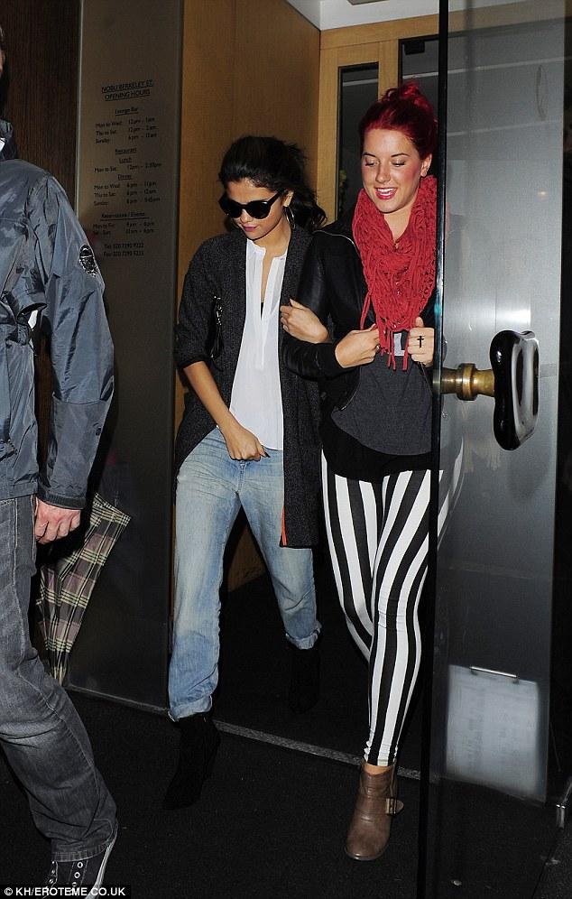 Oversized: Tiny Selena seemed to be wearing big everything on Monday night