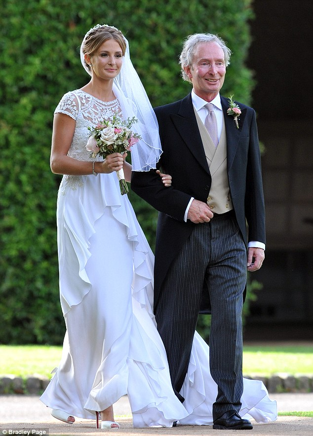 Blushing bride: Millie Mackintosh walks with her father to the church where she will marry Professor Green