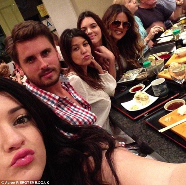 Taking her mind off things: Khloe posed for a family portrait alongside Kylie Jenner, Scott Disick, half sister Kourtney Kardashian and Kendall Jenner