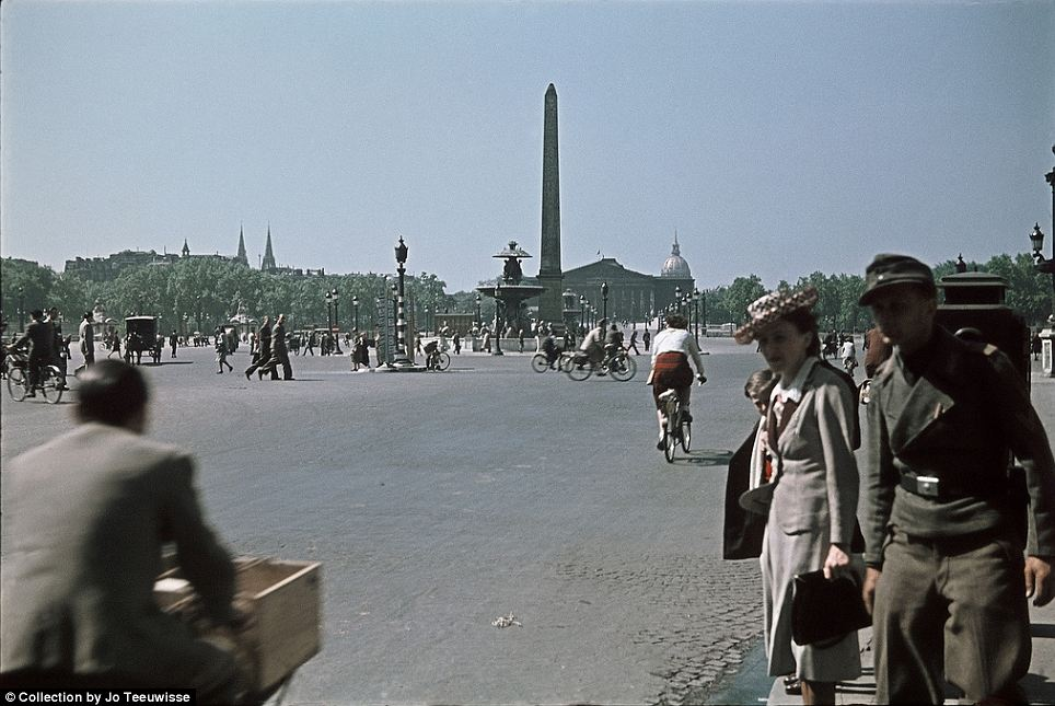 Symbol of empire: A soldier and civilians mill around near Cleopatra's Needle in the Place de la Concorde, one of three obelisks taken from Egypt and re-erected in Paris, London and New York during the 19th Century
