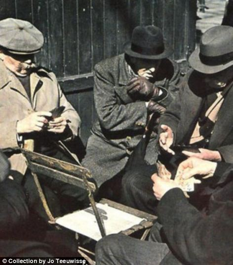 and elderly men huddle around a chair as they play cards (right)