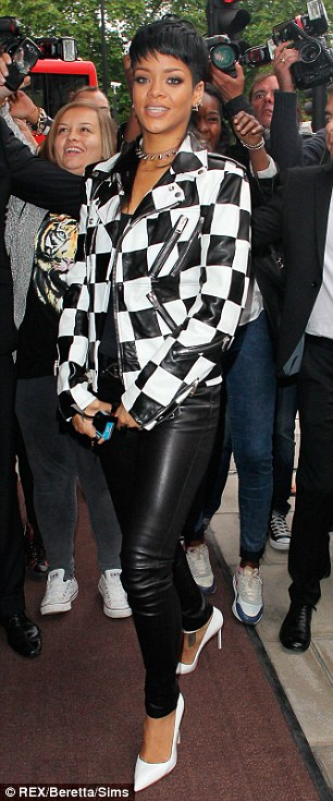 Mod-ern style: Rihanna showed off a longer Mohican look after her mullet hairdo was roundly criticised