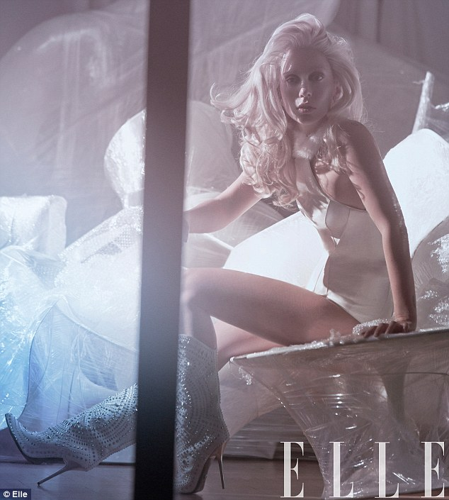 Softer side: Lady Gaga shows a softer side as she poses in a new photo shoot for US Elle magazine