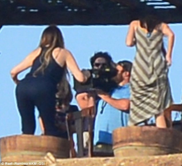 Cheers: Khloe and half-sister Kendall Jenner were seen crushing grapes with their feet to make wine while filming Keeping Up With The Kardashians