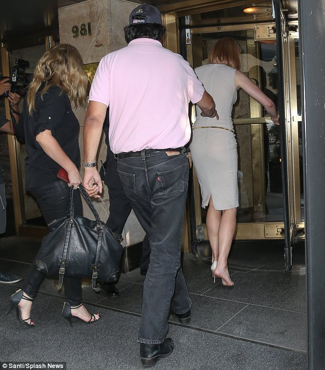 Making a quick getaway: The 46-year-old hobbled into her hotel wearing just one of her high heels