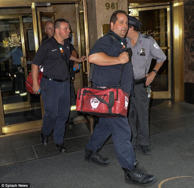 Doing OK: Paramedics were spotted leaving the hotel after treating Nicole for minor injuries