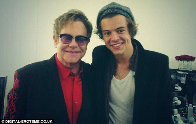 Posing up: After the show, Sir Elton posed alongside Harry, after giving him a shout out during the show