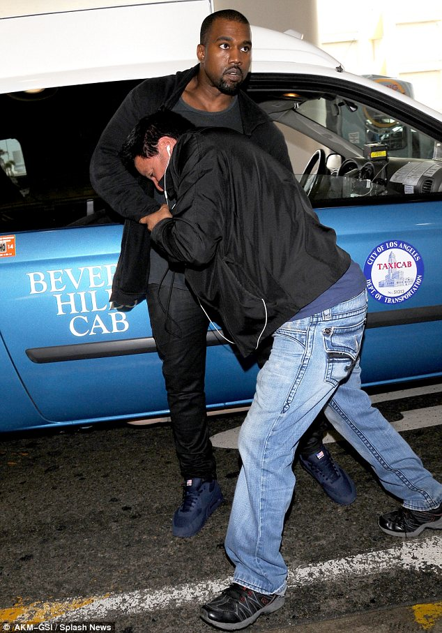 Clash: Kanye was involved in an altercation with a photographer at LAX in July