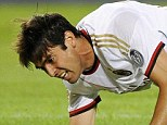Sidelined: Kaka falls to his knees during AC Milan's 2-2 draw with Torino