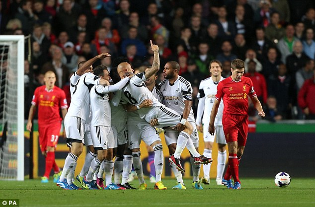 Hero: Jonjo Shelvey celebrates scoring against his former club after just one minute