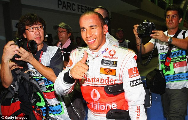 Thumbs up: Lewis Hamilton was a winner in Singapore in 2009 when he cruised to victory around the Marina Bay circuit
