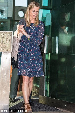 Kate McCann mother of missing Madeleine leaving a Portuguese court after the start of the family's libel action against a former local police chief