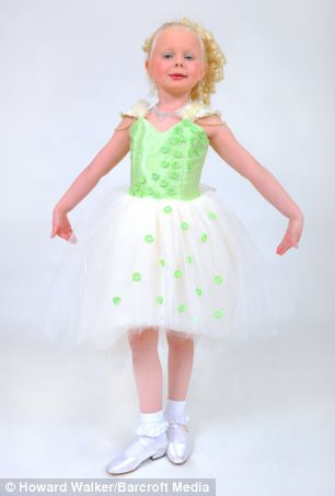 Mrs Adlington, a stay-at-home mother, claims the beauty pageants have transformed her children for the better. Above, Poppy poses in a green princess dress