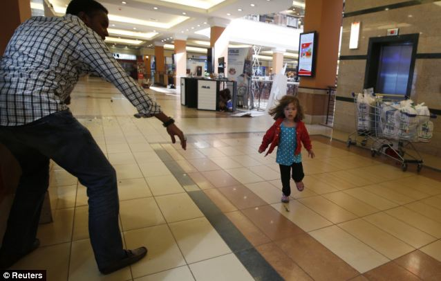 Fleeing: A child runs to safety across the shopping mall
