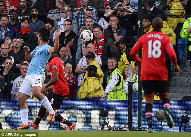 Opening up: Aguero scores the opening goal of the derby in the first half