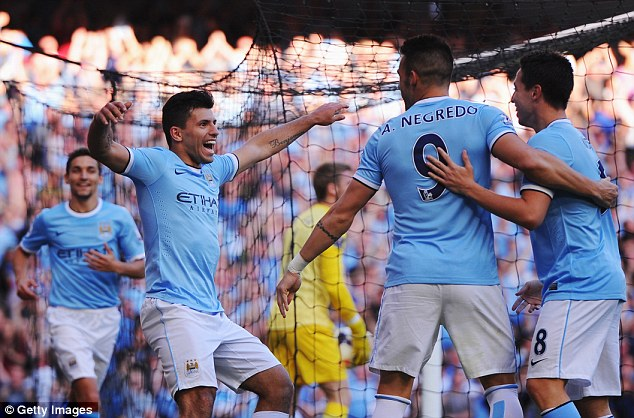 It's getting better and better: Aguero celebrates with Alvaro Negredo and Samir Nasri