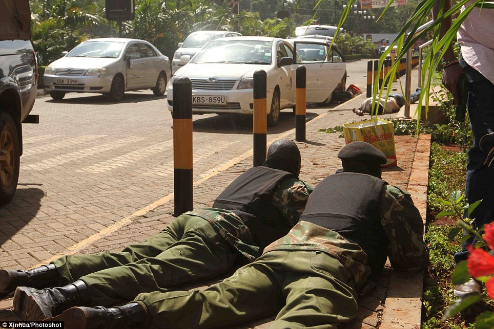 Response: Soldiers take positions outside the shopping centre in Nairobi. Dozens of people have been killed after masked gunmen stormed the mall and held shoppers