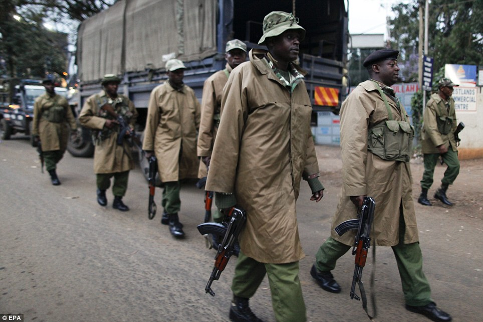 Tense: Kenyan paramilitary officers walk towards a small shopping arcade adjacent to the Westgate shopping mall where the hostage situation continues