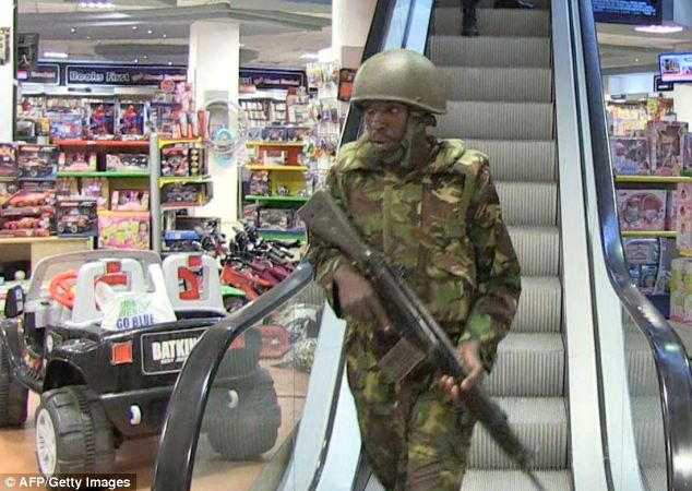 Military forces take position inside a shopping mall following the attack by masked gunmen in Nairobi