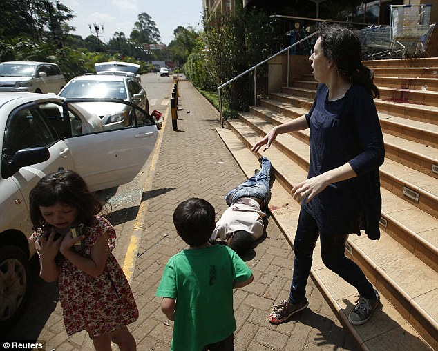 Horror: Their mother, Amber, walks past the body of a man as they escape the Westgate shopping centre